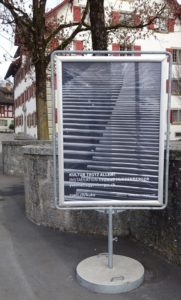 entlang plakat im weltformat dorfzentrum rüti 2021